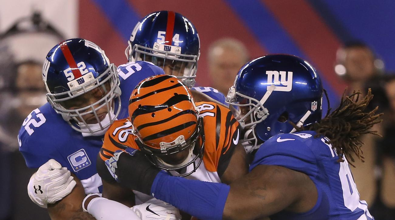 Cincinnati Bengals wide receiver A.J. Green (18) pushes for extra yards against New York Giants outside linebacker Jonathan Casillas (52), defensive end Olivier Vernon (54) and defensive end Jason Pierre-Paul (90) during the first quarter of an NFL footba