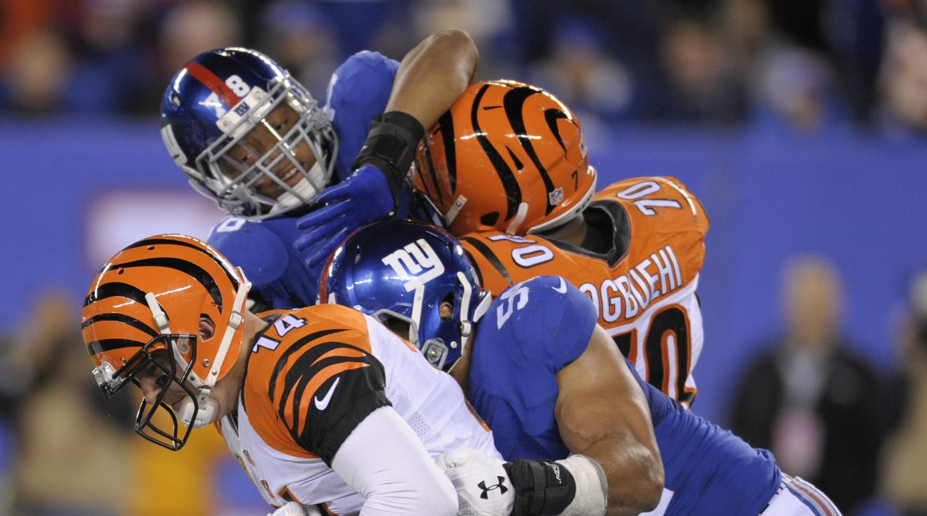 Cincinnati Bengals quarterback Andy Dalton (14) is sacked by New York Giants defensive end Olivier Vernon (54) during the fourth quarter of an NFL football game, Monday, Nov. 14, 2016, in East Rutherford, N.J. (AP Photo/Bill Kostroun)