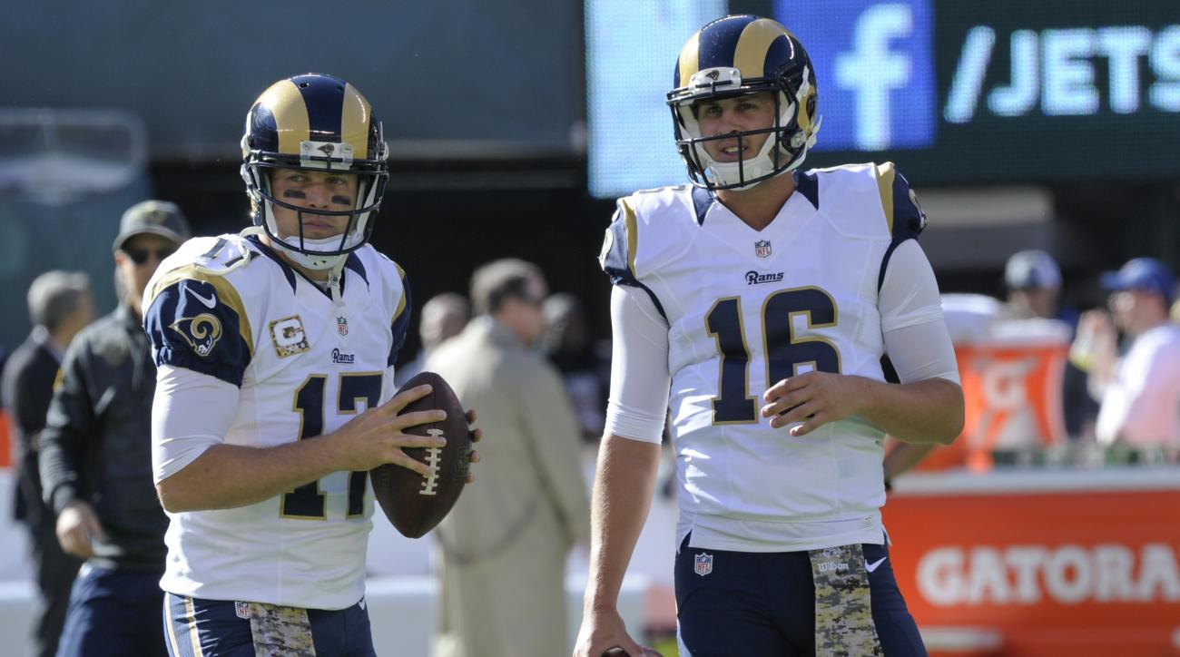 FILE - In this Nov. 13, 2016, file photo, Los Angeles Rams quarterbacks Case Keenum (17) and Jared Goff (16) warm up before an NFL football game against the New York Jets, in East Rutherford, N.J. A person with knowledge of the decision tells The Associat