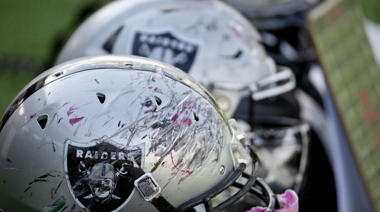 In this Nov. 5, 2016 photo, scratched up helmets belonging to the Raiders youth squad sit out before the team's American football game against the Buhos on the outskirts of Mexico City. The NFL returns to Mexico for the first time in 11 years when the Tex