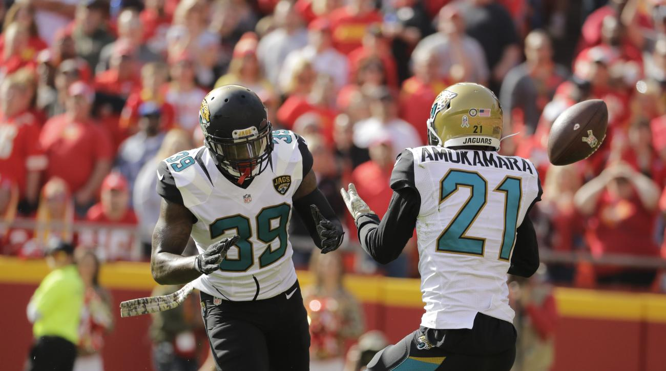 FILE - In this Nov. 6, 2016, file photo, Jacksonville Jaguars cornerback Prince Amukamara (21) nearly intercepts a ball with safety Tashaun Gipson (39) looking on, during the first half of an NFL football game against the Kansas City Chiefs, in Kansas Cit