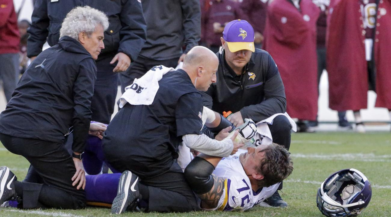 FILE - In this Nov. 13, 2016, file photo, Minnesota Vikings offensive tackle Jake Long (72) is helped up after an injury during the second half of an NFL football game against the Washington Redskins,  in Landover, Md. Another loss has triggered another r
