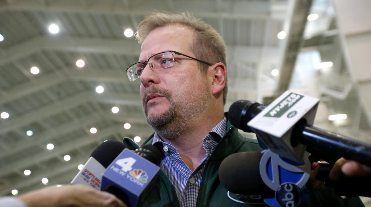 FILE - In this Jan. 14, 2016, file photo, New York Jets general manager Mike Maccagnan speaks to reporters at the team's NFL football training center in Florham Park, N.J. Maccagnan says he has no regrets about bringing back Ryan Fitzpatrick, despite the