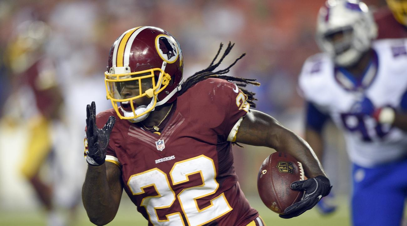 This Aug. 26, 2016 photo shows Washington Redskins running back Robert Kelley running with the ball during the first half of an NFL preseason football game against the Buffalo Bills in Landover, Md. Kelley is keeping negative runs to a minimum and having