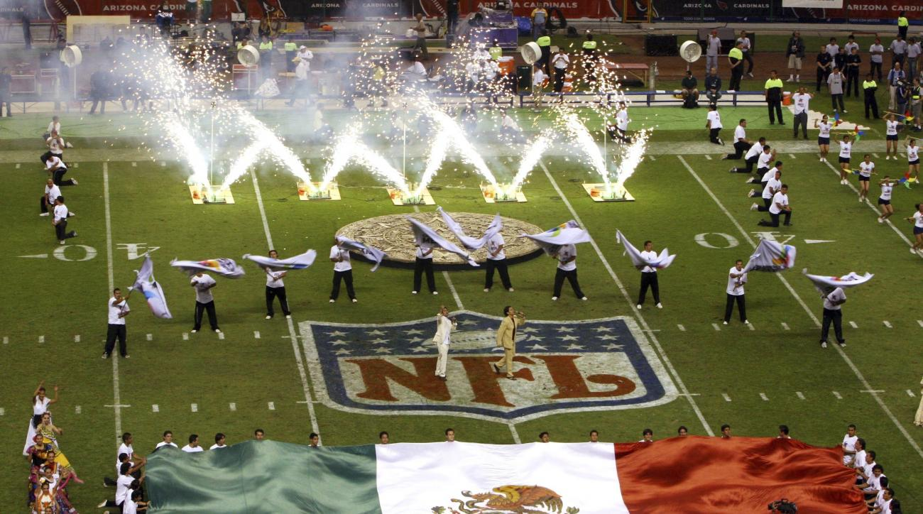 FILE - In this Oct. 2, 2005, file photo, performers are shown prior to the start of a regular season NFL game between the Arizona Cardinals and San Francisco 49ers at Azteca Stadium in Mexico City, Mexico. Eleven years after the network telecast an NFL ga