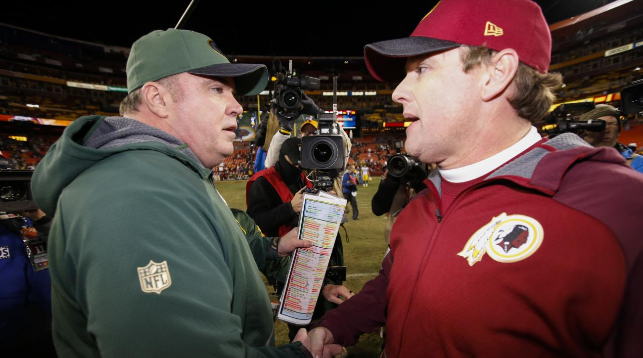 FILE - In this Jan. 10, 2016, file photo, Green Bay Packers head coach Mike McCarthy, left,and Washington Redskins head coach Jay Gruden shake hands after an NFL wild card playoff football game in Landover, Md. The Packers (4-5) return to the scene of the