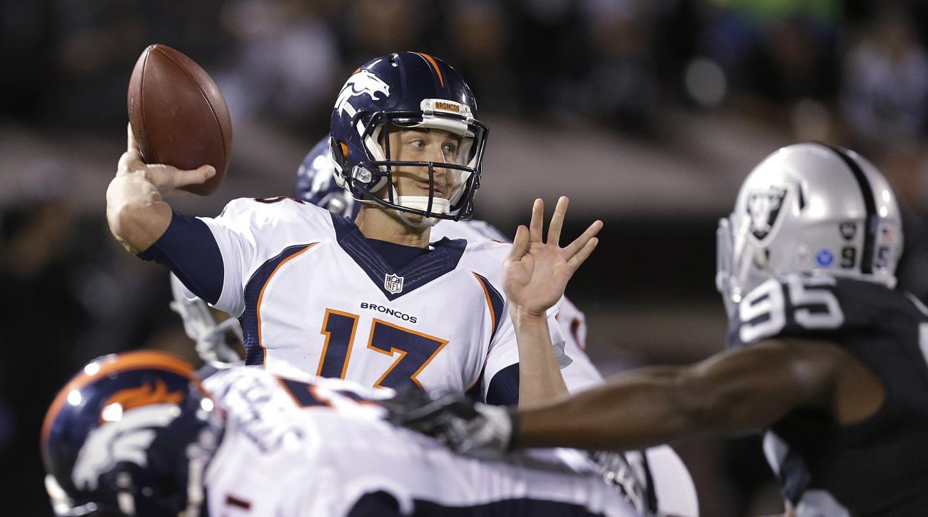FILE - In this Nov. 6, 2016, file photo, Denver Broncos quarterback Trevor Siemian (13) passes against the Oakland Raiders during an NFL football game in Oakland, Calif. The Broncos sport the youngest backfield in the NFL. Second-year quarterback Trevor S