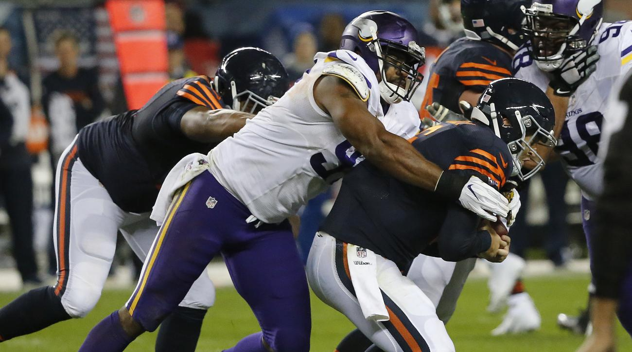 FILE - In this Oct. 31, 2016, file photo, Minnesota Vikings defensive end Everson Griffen (97) sacks Chicago Bears quarterback Jay Cutler (6) during the second half of an NFL football game, in Chicago. Overshadowed by the injuries and ineffectiveness on M
