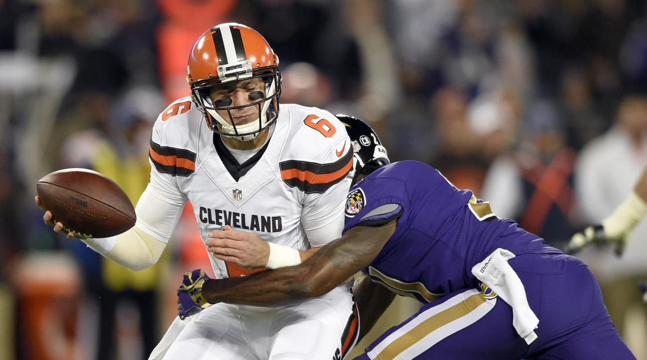 FILE - In this Nov. 10, 2016, file photo, Cleveland Browns quarterback Cody Kessler, left, is sacked by Baltimore Ravens free safety Lardarius Webb during the first half an NFL football game, in Baltimore. Its going to be snowy and windy when the winless