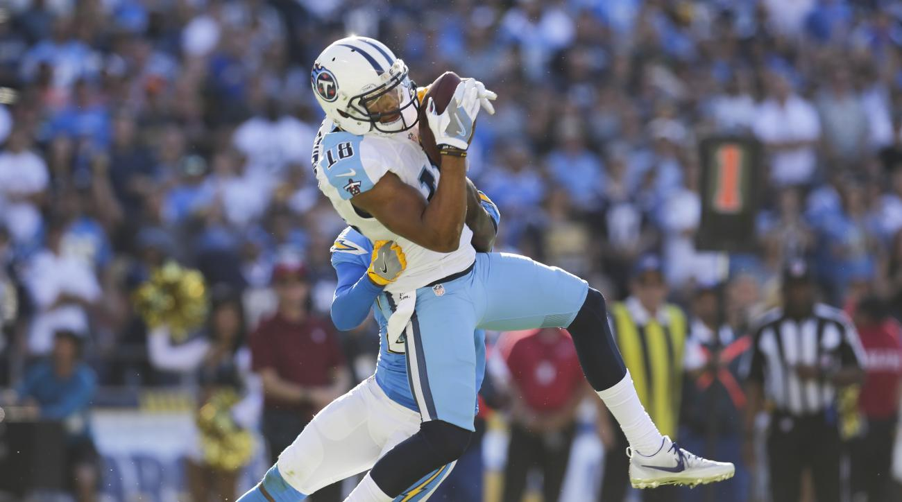 FILE-- In this Nov. 6, 2016 file photo, Tennessee Titans wide receiver Rishard Matthews (18) hauls in a touchdown pass during an NFL football game against the San Diego Chargers in San Diego. Matthews now has six touchdowns over his past six games as Tenn