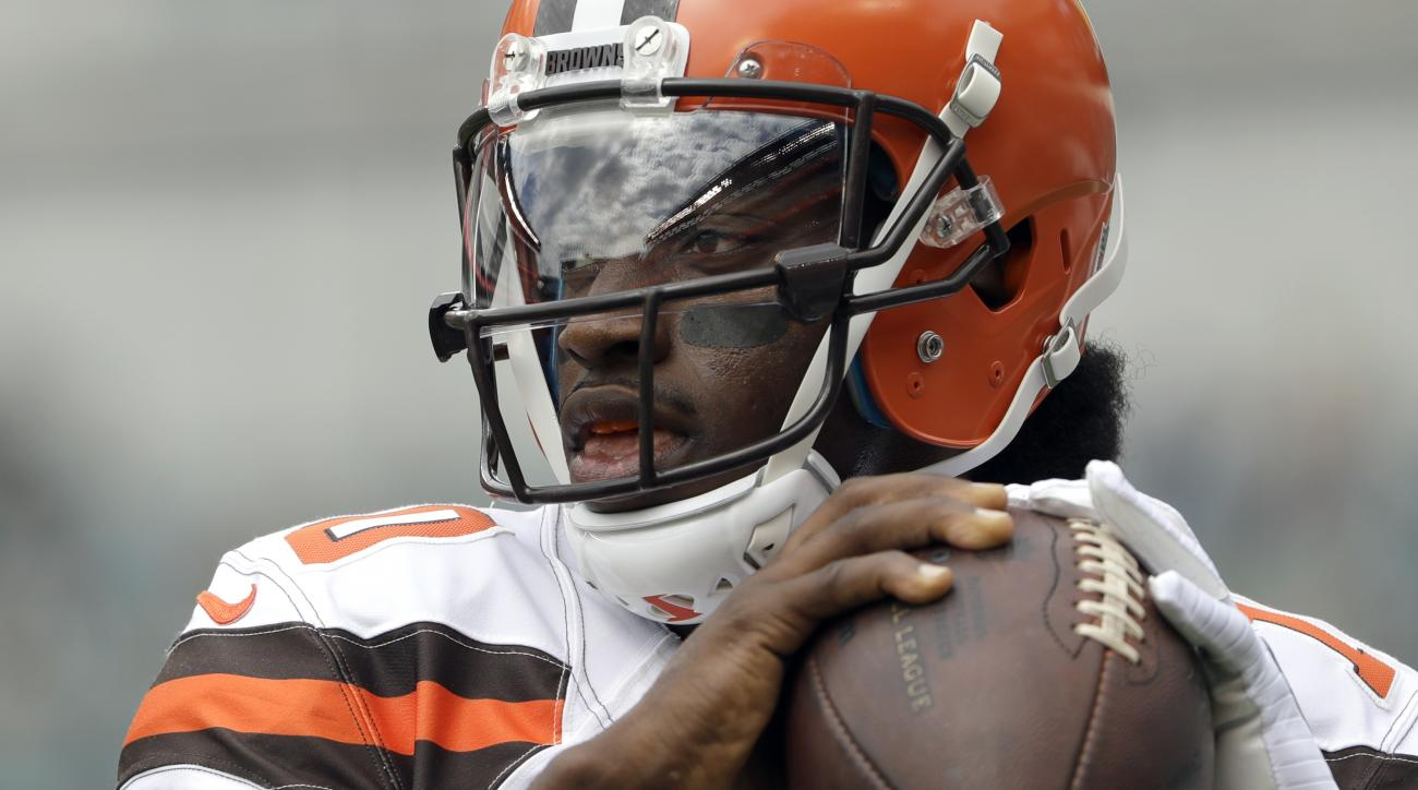 FILE - In this Sept. 11, 2016, file photo, Cleveland Browns' Robert Griffin III warms up before an NFL football game against the Philadelphia Eagles, in Philadelphia. Griffin III will practice next week and it remains possible hell play again this season.