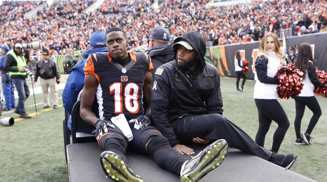 Cincinnati Bengals wide receiver Cody Core (16) is carted off the field after an apparent injury in the first half of an NFL football game against the Buffalo Bills, Sunday, Nov. 20, 2016, in Cincinnati. (AP Photo/Frank Victores)