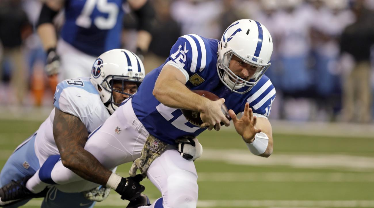 Indianapolis Colts quarterback Andrew Luck (12) is tackled by Tennessee Titans defensive tackle Jurrell Casey (99) during the first half of an NFL football game in Indianapolis, Sunday, Nov. 20, 2016. (AP Photo/Darron Cummings)