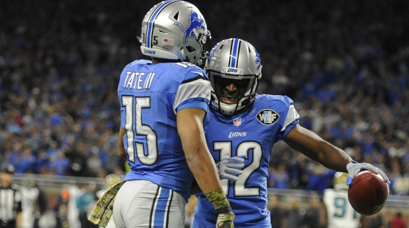 Detroit Lions wide receiver Andre Roberts (12) is congratulated by teammate Golden Tate (15) after scoring on a 55-yard punt return during the first half of an NFL football game against the Jacksonville Jaguars, Sunday, Nov. 20, 2016 in Detroit. (AP Photo