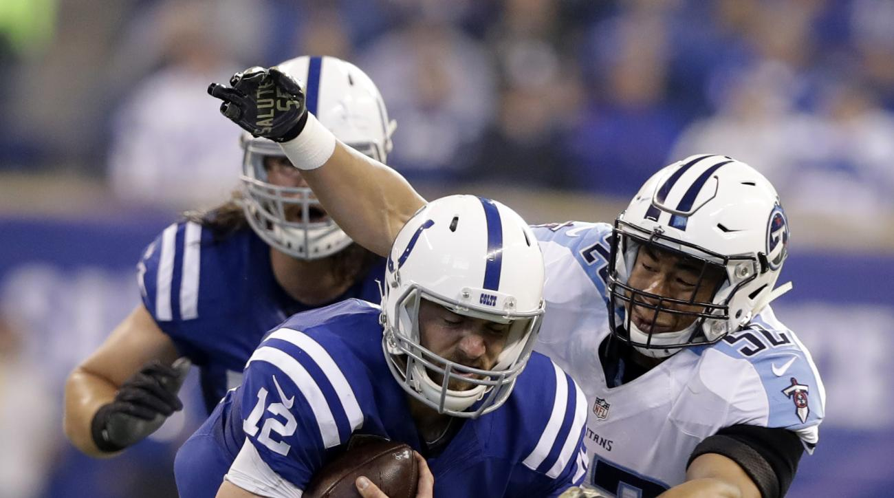 Indianapolis Colts quarterback Andrew Luck (12) is tackled by Tennessee Titans linebacker Aaron Wallace (52) during the first half of an NFL football game in Indianapolis, Sunday, Nov. 20, 2016. (AP Photo/Darron Cummings)