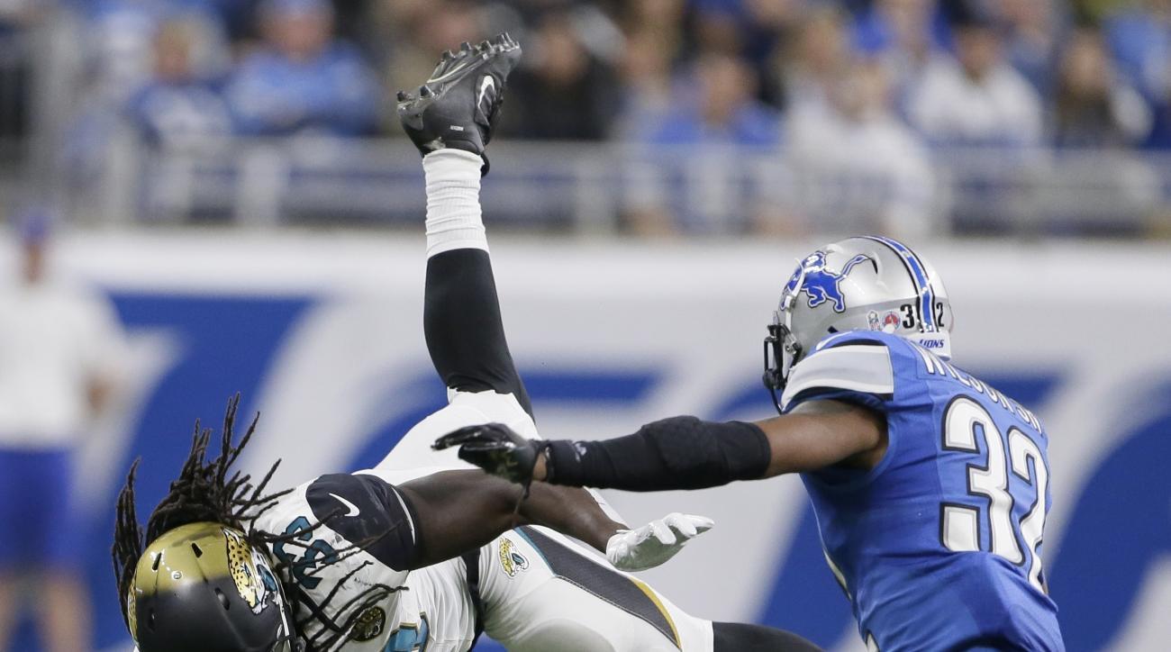 Jacksonville Jaguars running back Chris Ivory (33) leaps over a Detroit Lions defender during the second half of an NFL football game, Sunday, Nov. 20, 2016 in Detroit. (AP Photo/Duane Burleson)