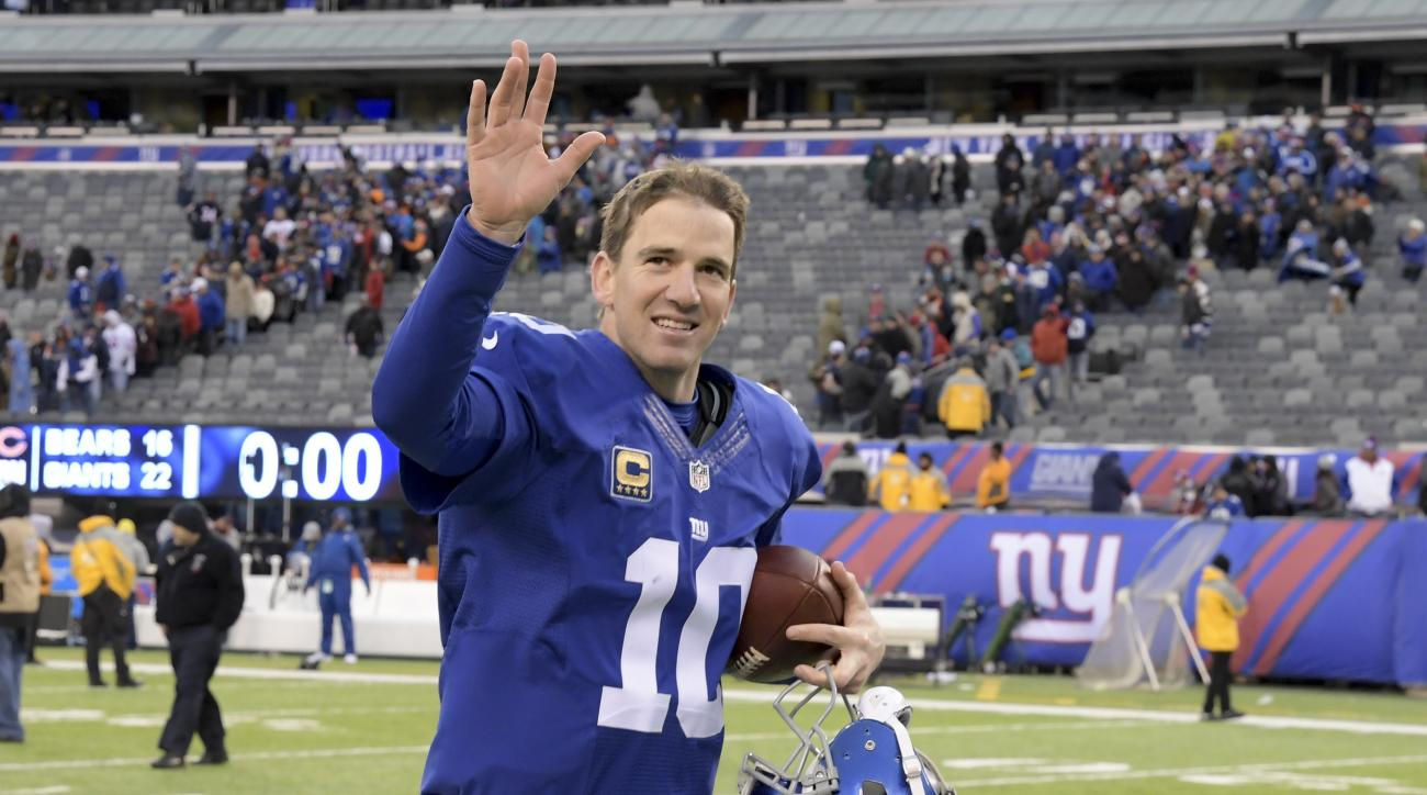 New York Giants quarterback Eli Manning (10) waves to fans as he leaves the field after playing against the Chicago Bears in an NFL football game, Sunday, Nov. 20, 2016, in East Rutherford, N.J. The Giants won 22-16. (AP Photo/Bill Kostroun)