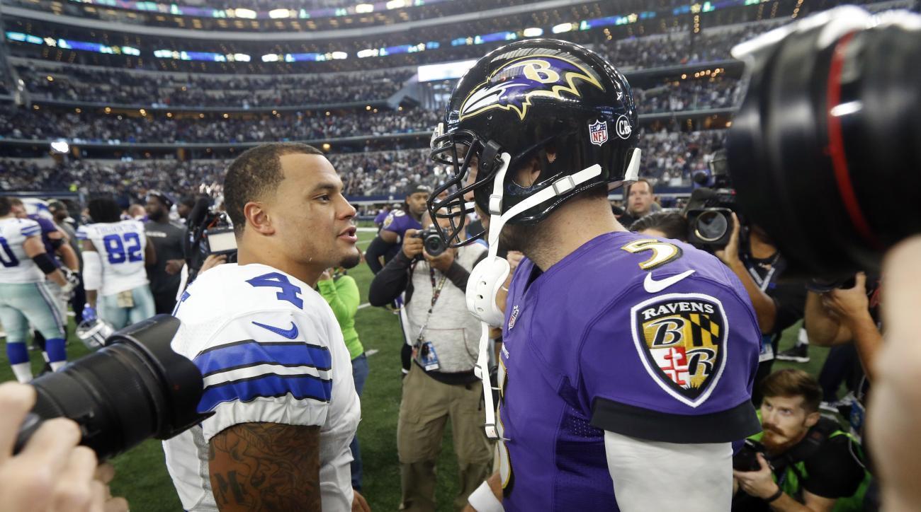 Dallas Cowboys quarterback Dak Prescott (4) and Baltimore Ravens quarterback Joe Flacco (5) greet each other after their NFL football game, Sunday, Nov. 20, 2016, in Arlington, Texas. (AP Photo/Michael Ainsworth)
