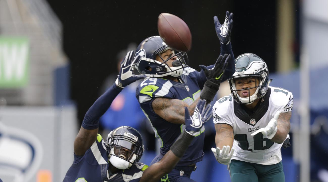 Seattle Seahawks cornerback Jeremy Lane (20) and free safety Earl Thomas, center, break up a pass intended for Philadelphia Eagles wide receiver Bryce Treggs, right, in the first half of an NFL football game, Sunday, Nov. 20, 2016, in Seattle. (AP Photo/S