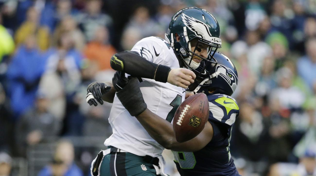 Philadelphia Eagles quarterback Carson Wentz fumbles as he is hit by Seattle Seahawks defensive end Cliff Avril in the second half of an NFL football game, Sunday, Nov. 20, 2016, in Seattle. The ball was recovered by the Eagles. (AP Photo/John Froschauer)