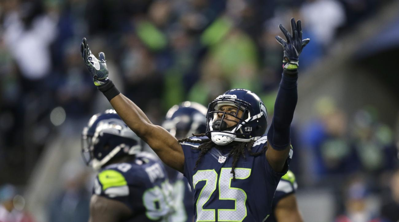 Seattle Seahawks cornerback Richard Sherman (25) reacts with the crowd after a play against the Philadelphia Eagles in the second half of an NFL football game, Sunday, Nov. 20, 2016, in Seattle. (AP Photo/Stephen Brashear)