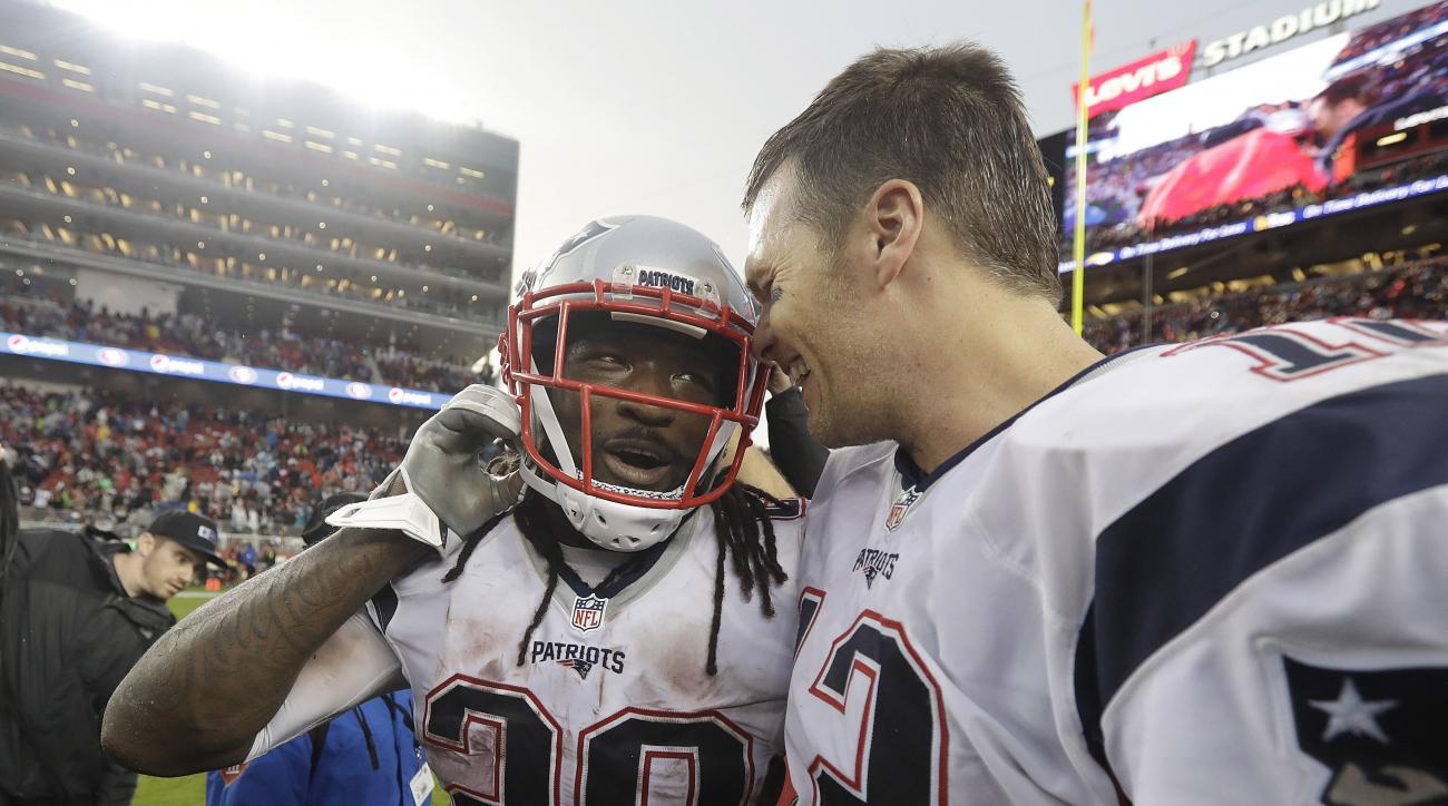New England Patriots running back LeGarrette Blount (29) and quarterback Tom Brady (12) celebrate after the Patriots beat the San Francisco 49ers in an NFL football game in Santa Clara, Calif., Sunday, Nov. 20, 2016. (AP Photo/Marcio Jose Sanchez)