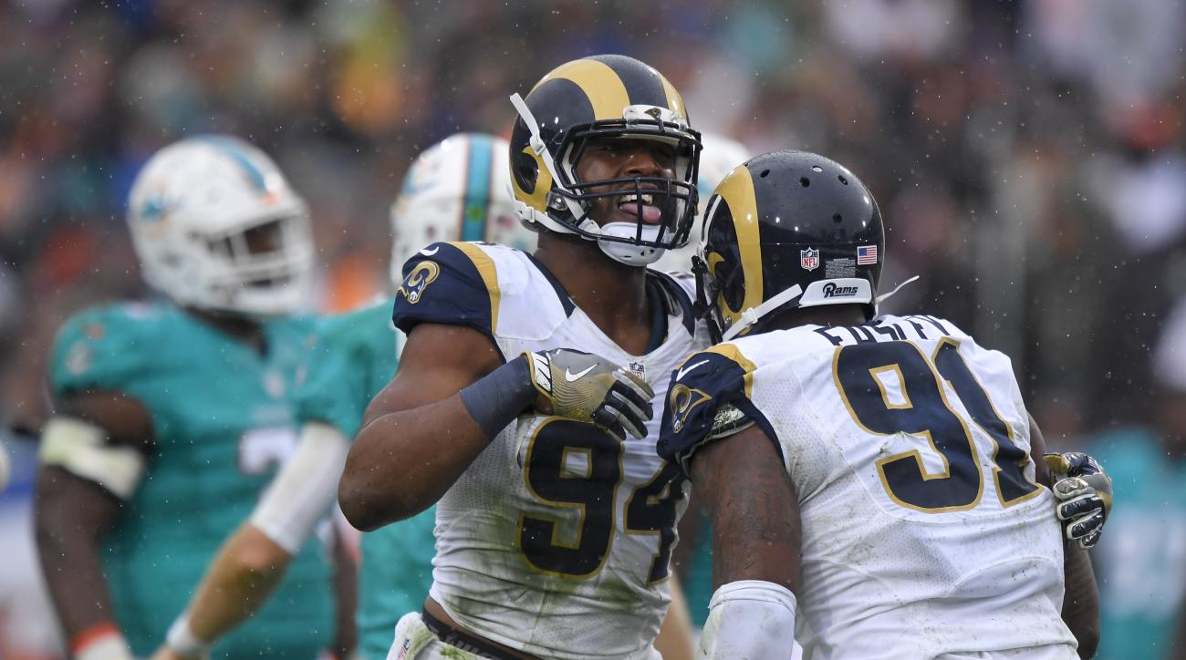Los Angeles Rams defensive end Robert Quinn (94) celebrates after sacking Miami Dolphins quarterback Ryan Tannehill with defensive tackle Dominique Easley during the the first half of an NFL football game Sunday, Nov. 20, 2016, in Los Angeles. (AP Photo/M