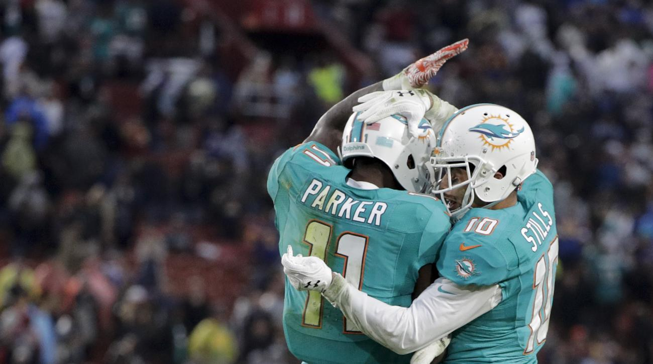 Miami Dolphins wide receiver DeVante Parker celebrates after scoring with wide receiver Kenny Stills during the second half of an NFL football game against the Los Angeles Rams Sunday, Nov. 20, 2016, in Los Angeles. (AP Photo/Jae C. Hong)