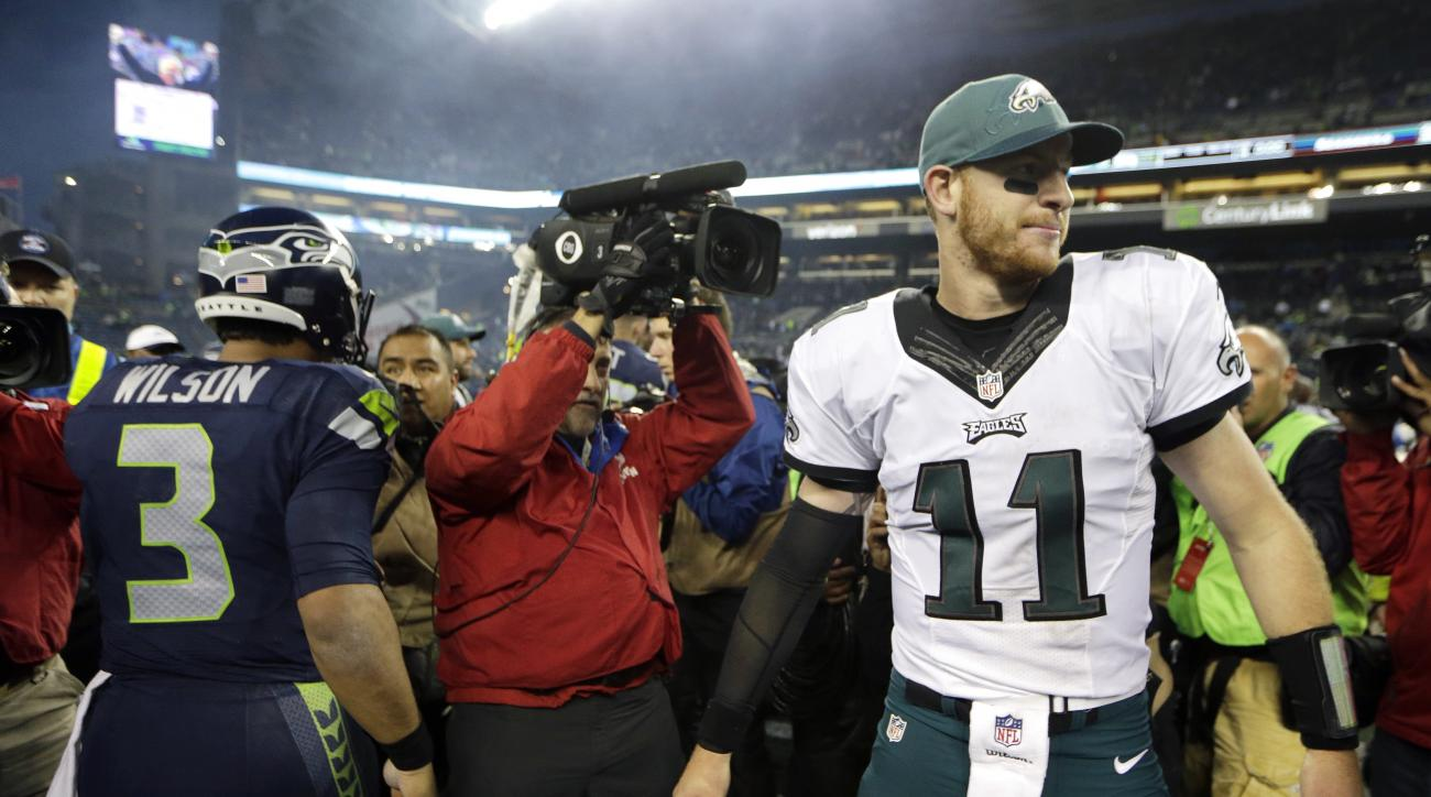 Philadelphia Eagles quarterback Carson Wentz (11) walks away after talking with Seattle Seahawks quarterback Russell Wilson (3) after an NFL football game, Sunday, Nov. 20, 2016, in Seattle. The Seahawks beat the Eagles 26-15. (AP Photo/John Froschauer)
