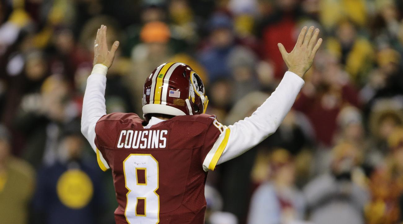 Washington Redskins quarterback Kirk Cousins (8) celebrates running back Rob Kelley's touchdown during the second half of an NFL football game against the Green Bay Packers in Landover, Md., Sunday, Nov. 20, 2016. (AP Photo/Mark Tenally)