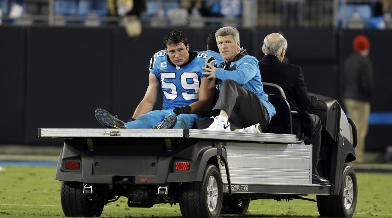 FILE - In this Nov. 17, 2016, file photo, Carolina Panthers' Luke Kuechly (59) is taken off the field after being injured in the second half of an NFL football game against the New Orleans Saints, in Charlotte, N.C.  Five Panthers players are in the NFL c