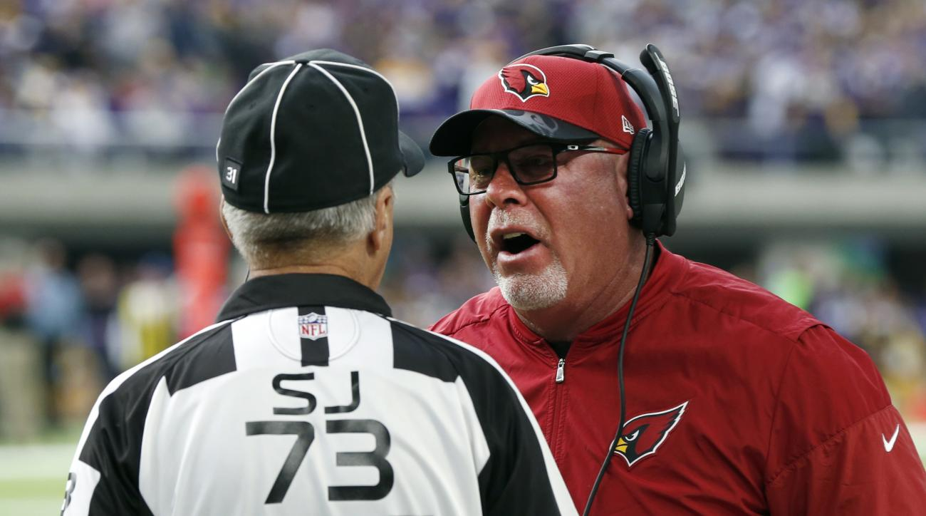 Arizona Cardinals head coach Bruce Arians, right, argues a call with side judge Joe Larrew during the first half of an NFL football game against the Minnesota Vikings Sunday, Nov. 20, 2016, in Minneapolis. Arians was in the hospital Monday after feeling i