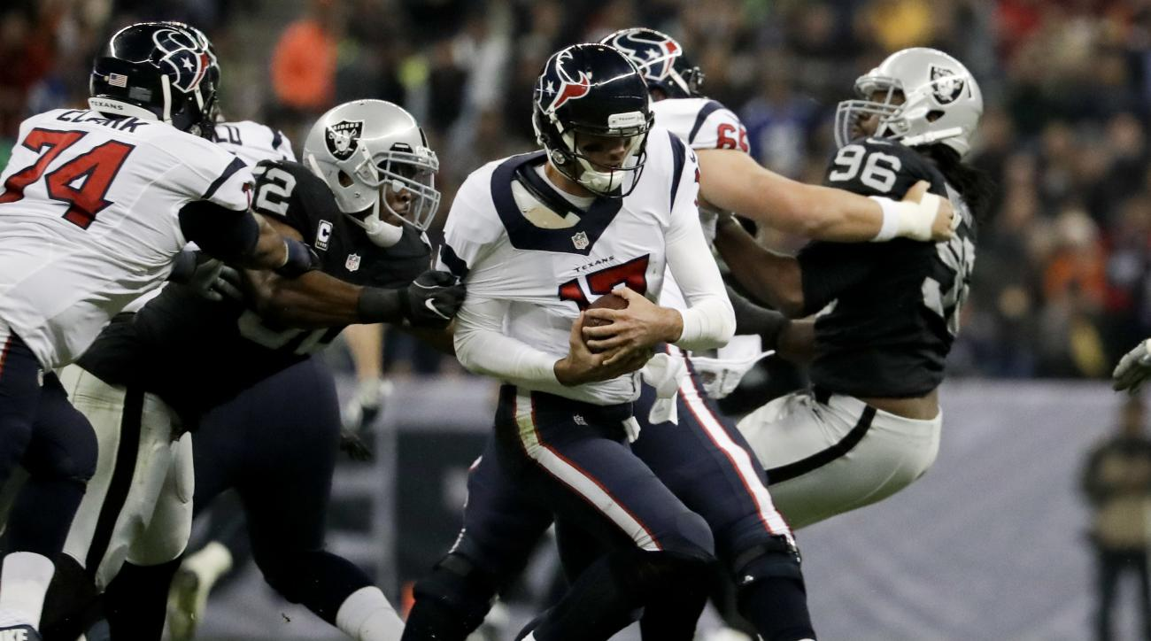 Oakland Raiders defensive end Khalil Mack (52) gets a hand on Houston Texans quarterback Brock Osweiler during the first half of an NFL football game Monday, Nov. 21, 2016, in Mexico City. (AP Photo/Rebecca Blackwell)