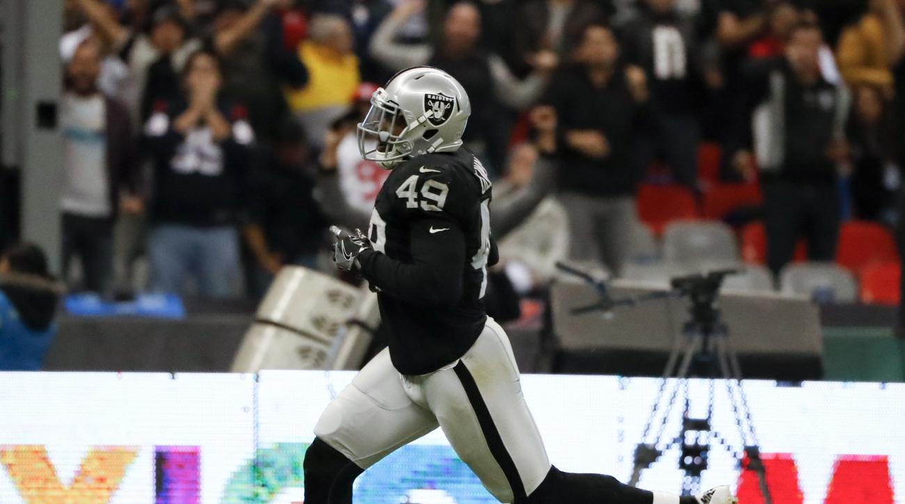 Oakland Raiders fullback Jamize Olawale scores a touchdown during the second half of an NFL football game against the Houston Texans Monday, Nov. 21, 2016, in Mexico City. (AP Photo/Eduardo Verdugo)