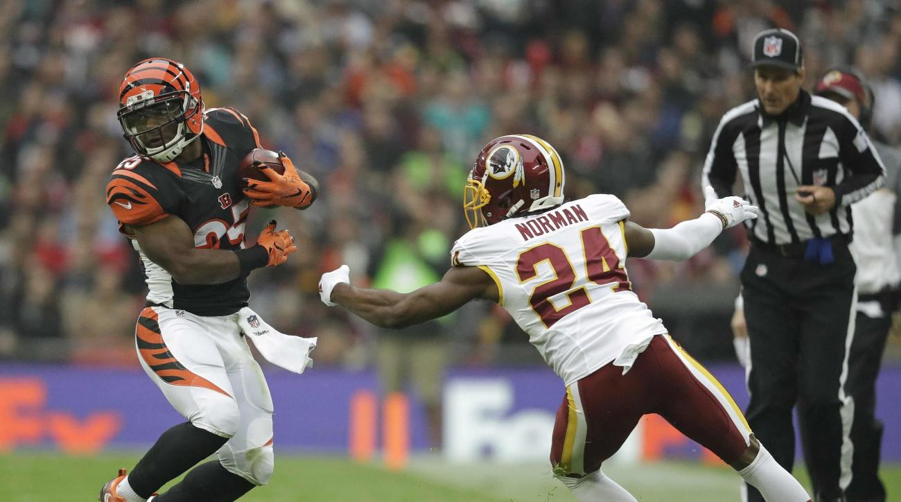 FILE - In this Oct. 30, 2016 file photo, Washington Redskins cornerback Josh Norman (24) reaches for Cincinnati Bengals running back Giovani Bernard (25) during an NFL Football game at Wembley Stadium in London. Normans eyes lit up as he reflected on the
