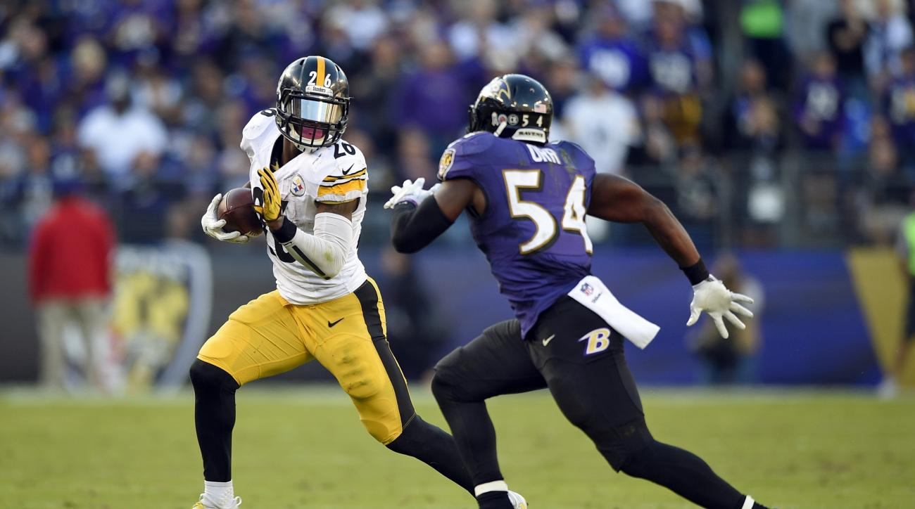FILE - In this Nov. 6, 2016, file photo, Pittsburgh Steelers running back Le'Veon Bell, left, rushes the ball against Baltimore Ravens inside linebacker Zach Orr in the second half of an NFL football game, in Baltimore. The Ravens bid to reach the postsea