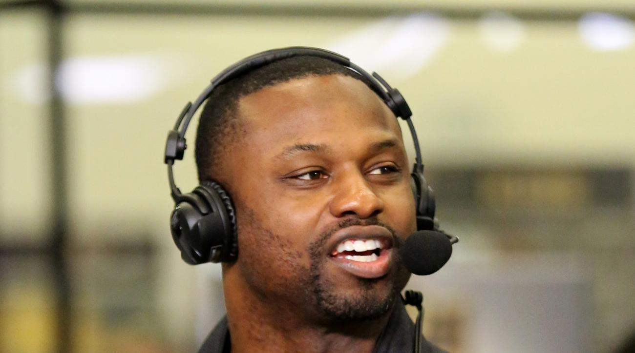 FILE - In this Feb. 3, 2016, file photo, former NFL Player Bart Scott speaks during an interview on Radio Row at the NFL Media Center during Super Bowl Week in San Francisco. Millions upon millions of dollars can bring dozens upon dozens of problems for N