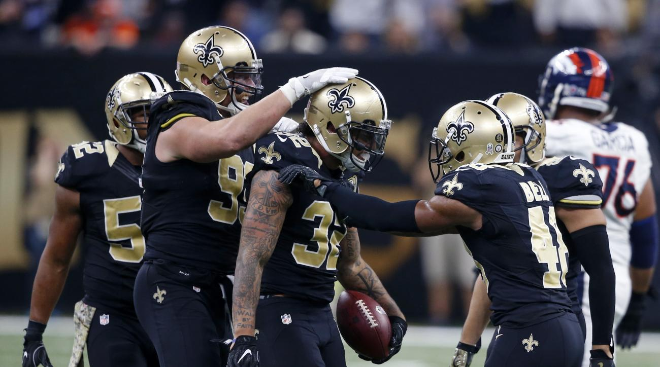 FILE -  In this Sunday, Nov. 13, 2016 file photo, New Orleans Saints strong safety Kenny Vaccaro (32) celebrates his interception with defensive end Paul Kruger (99) and free safety Vonn Bell (48) in the second half of an NFL football game in New Orleans.