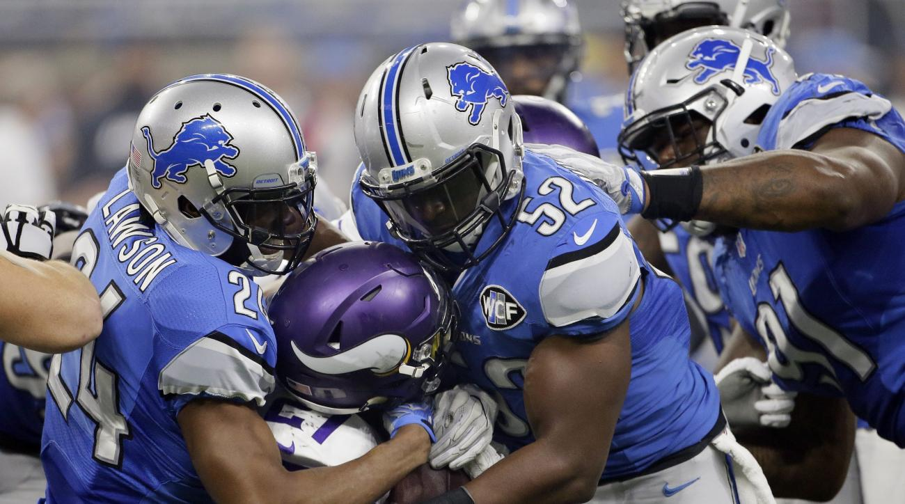 Minnesota Vikings running back Jerick McKinnon (21) is stopped by Detroit Lions cornerback Nevin Lawson (24) and outside linebacker Antwione Williams (52) during the second half of an NFL football game, Thursday, Nov. 24, 2016, in Detroit. (AP Photo/Duane