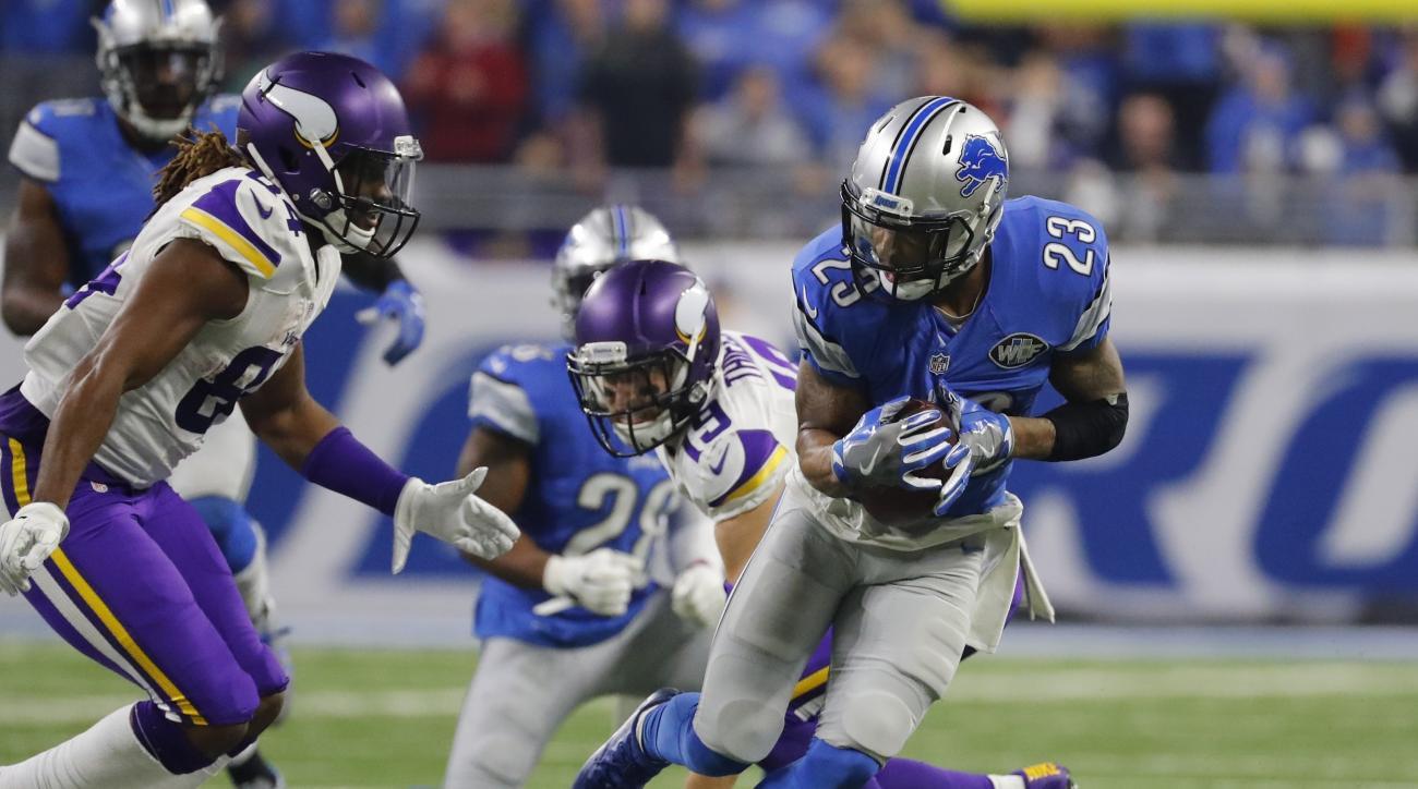 Detroit Lions cornerback Darius Slay (23) intercepts a pass intended for Minnesota Vikings wide receiver Adam Thielen (19) during the second half of an NFL football game, Thursday, Nov. 24, 2016 in Detroit. (AP Photo/Rick Osentoski)
