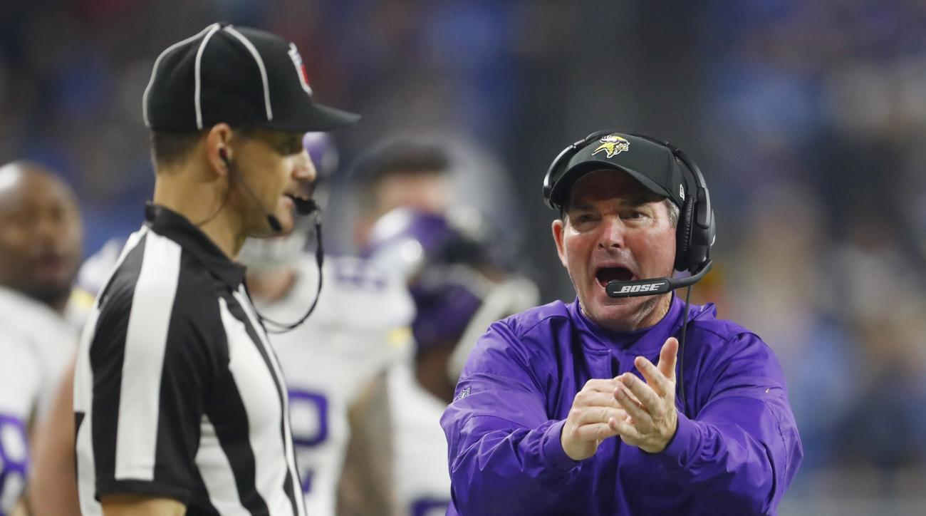 Minnesota Vikings head coach Mike Zimmer, right, argues a call during the second half of an NFL football game against the Detroit Lions, Thursday, Nov. 24, 2016, in Detroit. (AP Photo/Paul Sancya)