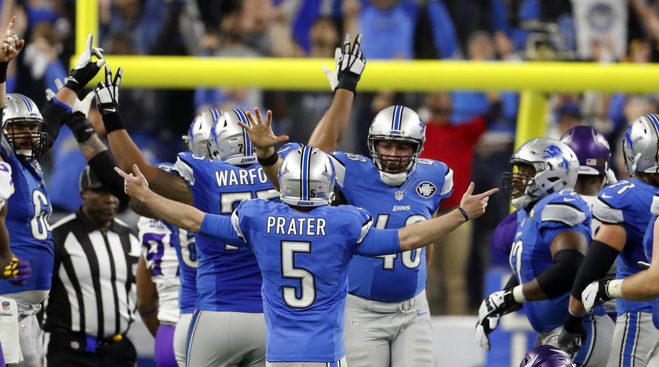 Detroit Lions kicker Matt Prater (5) is congratulated after making a 40-yard winning field goal during the second half of an NFL football game against the Minnesota Vikings, Thursday, Nov. 24, 2016, in Detroit. (AP Photo/Paul Sancya)