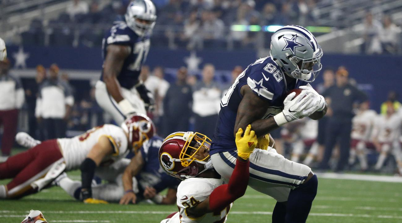 Washington Redskins cornerback Josh Norman (24) drags down Dallas Cowboys wide receiver Dez Bryant (88) after Bryant caught a pass in the second half of an NFL football game, Thursday, Nov. 24, 2016, in Arlington, Texas. (AP Photo/Ron Jenkins)