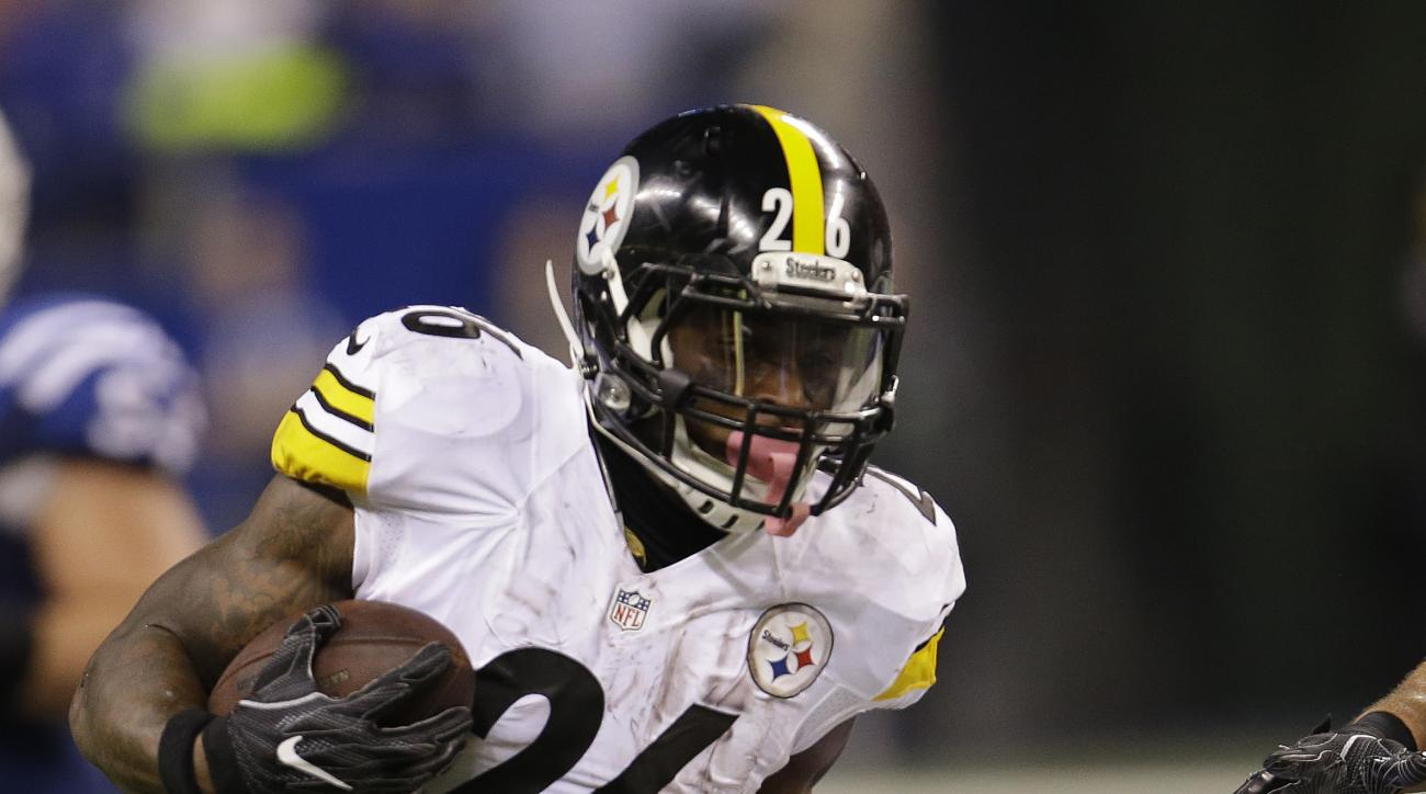 Pittsburgh Steelers' Le'Veon Bell (26) is tackled by Indianapolis Colts' T.J. Green during the second half of an NFL football game Thursday, Nov. 24, 2016, in Indianapolis. (AP Photo/AJ Mast)