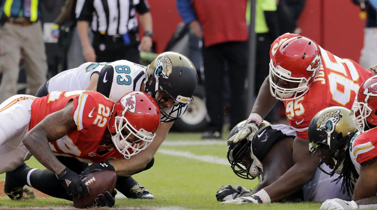 FILE - In a Sunday, Nov. 6, 2016 file photo, Kansas City Chiefs defensive back Marcus Peters (22) recovers a fumble in the end zone in front of Jacksonville Jaguars tight end Ben Koyack (83) during the second half of an NFL football game in Kansas City, M