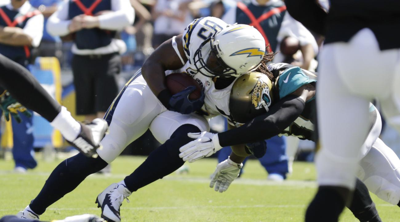 FILE - In a Sunday, Sept. 18, 2016 file photo, San Diego Chargers tight end Antonio Gates scores a touchdown as Jacksonville Jaguars strong safety Johnathan Cyprien defends during the first half of an NFL football game, in San Diego. With 109 career touch