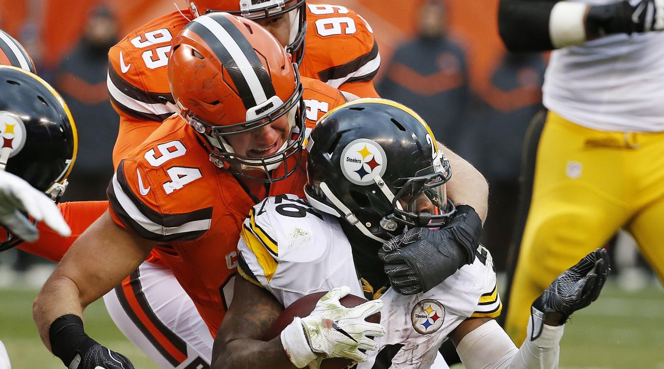 FILE - In a Sunday, Nov. 20, 2016 file photo, Pittsburgh Steelers running back Le'Veon Bell (26) is tackled by Cleveland Browns defensive end Carl Nassib (94) during the second half of an NFL football game in Cleveland. New York backup quarterback Ryan Na