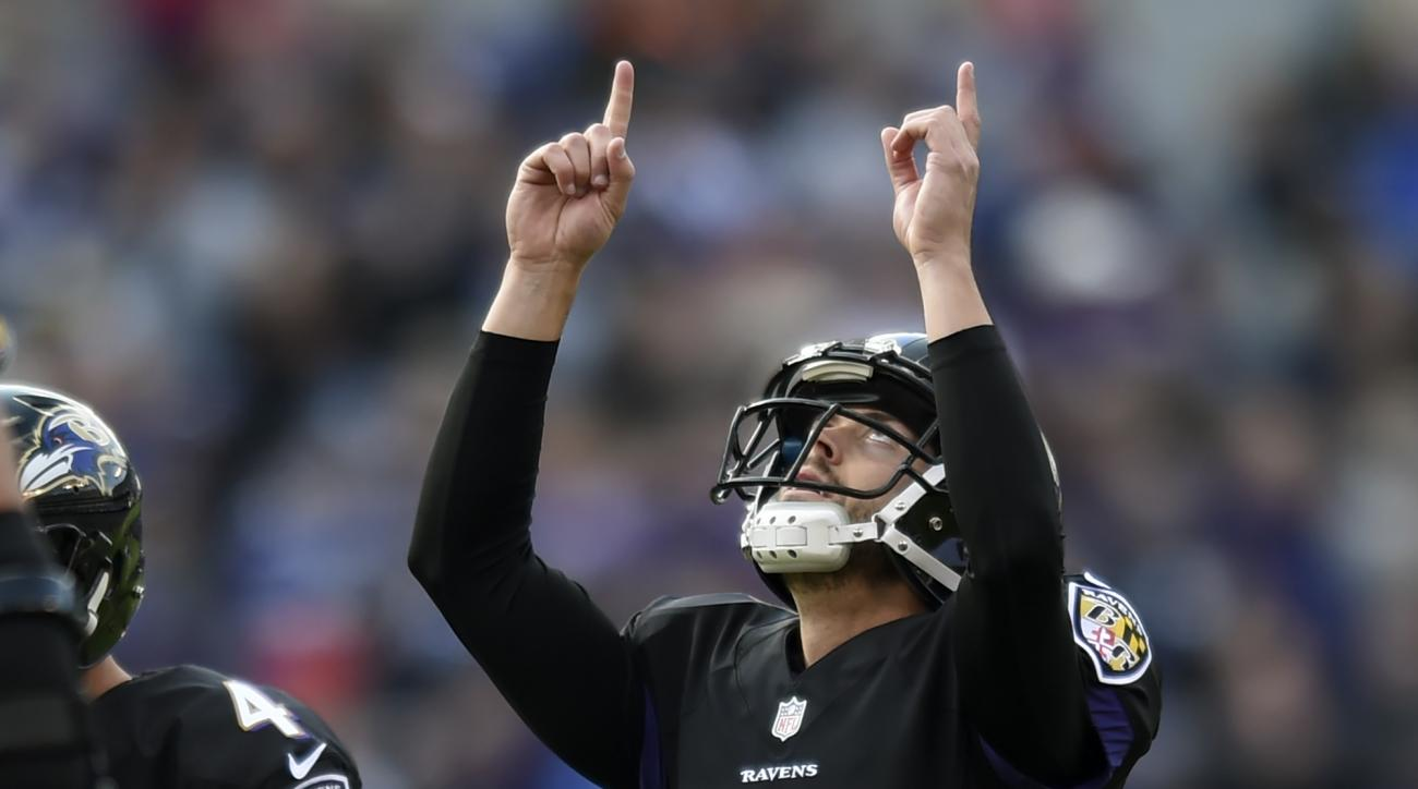 Baltimore Ravens kicker Justin Tucker (9) celebrates his field goal during the first half of an NFL football game against the Cincinnati Bengals in Baltimore, Sunday, Nov. 27, 2016. (AP Photo/Gail Burton)