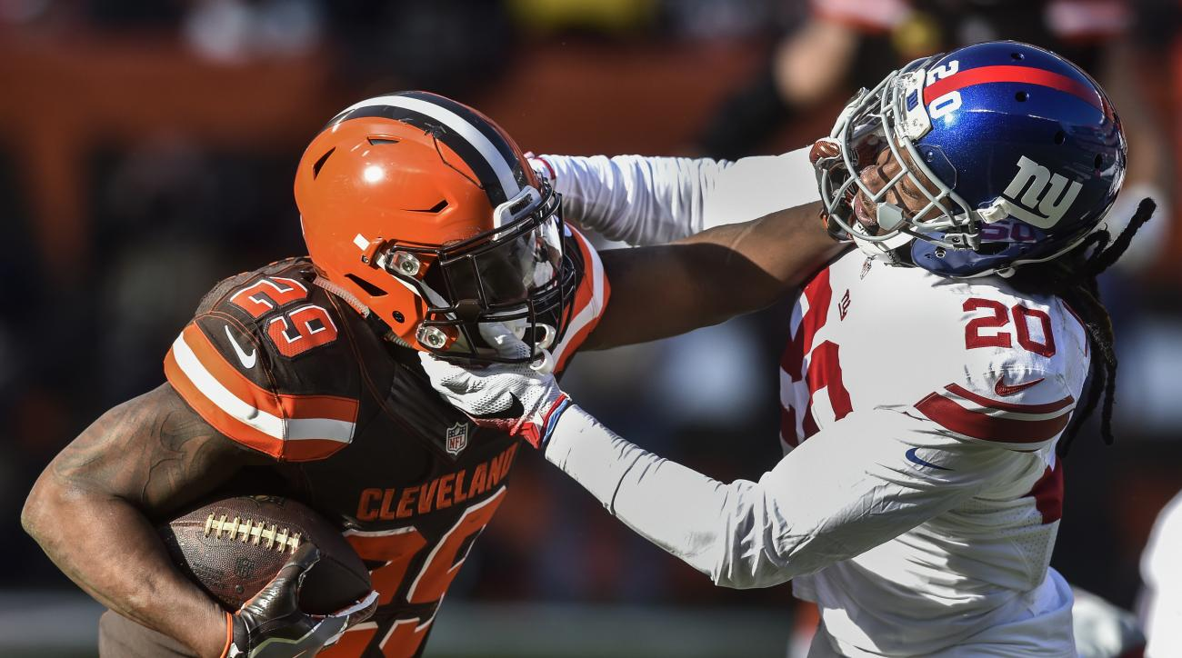 Cleveland Browns running back Duke Johnson (29) runs the ball against New York Giants cornerback Janoris Jenkins (20) in the first half of an NFL football game, Sunday, Nov. 27, 2016, in Cleveland. (AP Photo/David Richard)