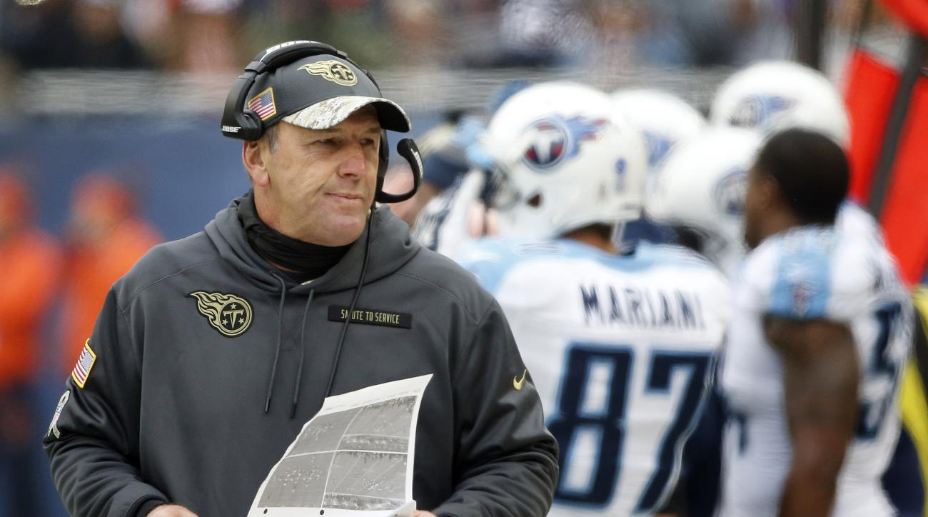 Tennessee Titans head coach Mike Mularkey looks at the chart on the sideline during the first half of an NFL football game against the Chicago Bears, Sunday, Nov. 27, 2016, in Chicago. (AP Photo/Charles Rex Arbogast)